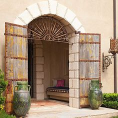 Capitalize on Unique Exterior Doors - Exterior doors might not, in fact, offer direct entrance to a home but instead be used as a passageway, allowing a moment of discovery and supplying interesting elements in the details of a home's exterior. Here, a small entrance area can be shut off from view, thanks to a matching pair of oversize wood and metal doors. Because the passageway doesn't need to be completely ...