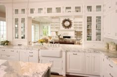 Glass cabinet doors, front and back, creates a very open feel. (Cultivate.com)