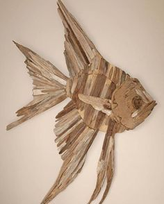 Gather together all the pieces of driftwood you are likely to use. Despite the fact that you watch for the driftwood to dry, you can begin on the tassels. The truly amazing thing about driftwood, is that it's usually smooth… Continue Reading → Driftwood Fish, Driftwood Wall Art, Driftwood Projects, Driftwood Sculpture, Driftwood Ideas, Woodworking Toys, Woodworking Projects, Woodworking Techniques, Woodworking Beginner