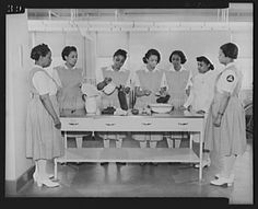 Nursing Students, 1942 Miss Thelma Harris, staff nurse, is shown instructing uncapped students on how to fill hot water bottles and ice caps in the year of 1942. Historic Photos From Howard University School Of Medicine.