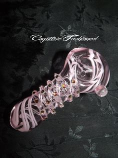 This gorgeous pink swirl glass pipe has beautiful color changing crystals from every direction! Beautiful and with detail! Girly Girly! 3.5 Inches Long Approx. Nice size bowl. Hand-blown and beautifully handcrafted! *****NOTE****: I normally ship out all items either same day or the next day...
