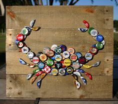 Crab Wall Art with Mixed Bottle Caps on Pallet Wood by ReclaimedDaisy on Etsy https://www.etsy.com/listing/277198878/crab-wall-art-with-mixed-bottle-caps-on