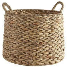 We could go on and on about how our round basket is a real natural. Crafted from water hyacinth and seagrass, our handsomely woven piece works in a den, office, bedroom, bath or closet. Ideal spot for stashing toys, shoes or magazines. Flexible handles make it easy to move, too—around and otherwise.