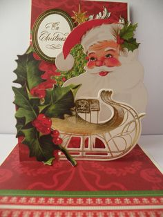 Anna Griffin Christmas Pop Up. I love the showbiz nature of these cards. Santa, sleigh, holly, Christmas tree, all the good stuff!