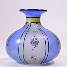 """Scailmont - Art Deco Vase - Ca. 1930, Belgium Beautiful Scailmont vase, decor ROSA, period 1930/1935.  Height 15 cm - Diameter 15.5 cm approx.  Branded Scailmont (on the side) and Dec. ROSA (on bottom).  Frosted glass vase divided into a silver coloured lining of vertical planes with herein a decoration in blue yellow and green """"enamel paint.""""  In excellent condition, no chips, just some scratches at the bottom. Price 1,350 euros"""