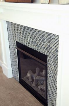 round aqua mosaic tile for the fireplace surround Inside