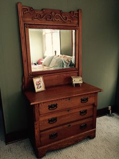 Antique oak dresser with mirror.