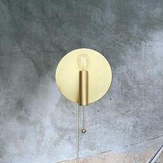 E2 Contract Lighting | Products | Pull Switch Wall Light CL-32906 | UK | Cl-32906 is a modern brushed brass wall light with a pull switch chain.