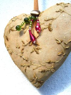Heart with beads - love the delicate embroidery.