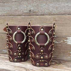Mens  Historical Reenactment Two Tone Dark Brown Scaled Leather Bracers with Antiqued Brass Etched Ring and Hardware