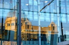 The very clever and very wonderful reflection of the Royal Exhibition Building on the sharp and shiny facade of the Melbourne Museum in Carlton Gardens.