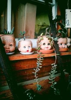 Doll Head Planters. Freaky and awesome. by nadia