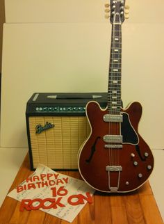 - Amplifier and electric guitar. The guitar is made of RCT., STRINGS - silver mouline thread.