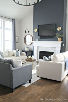 fireplace transformation with paint! Fireplace wall color is Cyberspace from Sherwin-Williams. It's an absolutely PERFECT dark gray/blue. Sometimes it looks navy, sometimes it's more dark gray.Fireplace wall color is Cyberspace from Sherwin-Williams. Navy Living Rooms, Accent Walls In Living Room, Living Room Colors, Living Room Grey, Home Living Room, Living Room Designs, Living Room Decor, Formal Living Rooms, White Fireplace