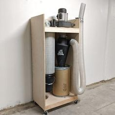 Modern and Mint Dust Collection Plans Workshop Plans, Workshop Ideas, Dust Collector Diy, Wood Pen Holder, Vinyl Record Holder, Shop Dust Collection, Garage Organization Tips, Record Display, Dust Extractor