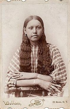 Comanche woman - circa 1885. The Comanche are a Plains Indian tribe whose historic territory, known as Comancheria, consisted of present day eastern New Mexico, southern Colorado, northeastern Arizona, southern Kansas, all of Oklahoma, and most of northwest Texas.