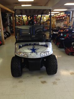 My dad buys lots of cool golf carts including this Dallas cowboys one... BOOOOOO GIANTS!!!!!!!!