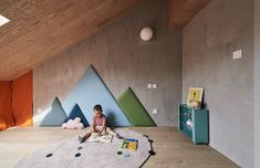 Kids Room, Rug Floor, and Light Hardwood Floor Mountain-shaped wall cushions line the wall of this cloistered playroom, echoing the peaked ceiling of the apartment. Photo 11 of 20 in A Loft Mezzanine Cleverly Enlarges This Small Beijing Flat Modern Kids, Modern Family, Home And Family, Urban Apartment, Family Apartment, Apartment Ideas, Bright Apartment, Brick Accent Walls, Sliding Door Design