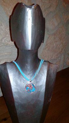 Colgante plateado con fimo turquesa y marron y cordon en antelina turquesa y cuerda marron