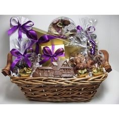 This basket says Good Luck in your new home and is brimming with delicious Enjou Chocolat: assorted chocolates, chocolate covered grahams, milk and dark chocolate nonpareils, chocolate covered Oreo's, Morristown's premiere almond butter crunch, Enjou's very own recipe of hot chocolate, chocolate covered pretzels, gourmet nuts, superb truffles and a chocolate house or key to munch on while unpacking. It's the best !Ingredients and basket or container may vary