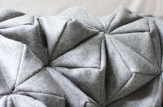 Bloom: a wool blanket inspired by origami