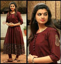 Maroon flaired kurti with antique gold thread motif on the sleeve n as an icing to the cake the contrast kalamkari skirting makes it a splendid day wear. Kalamkari Designs, Churidar Designs, Kurti Neck Designs, Kurti Designs Party Wear, Blouse Designs, Stylish Dress Designs, Stylish Dresses, Kurti Patterns, Dress Patterns