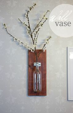 do it yourself wall vase- made with a few items from the hardware store, a wood board and recycled glass bottle