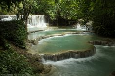 Kuang Si Waterfalls, Luang Prabang, Laos.  I traveled around Laos with a small backpack, so left the tripod behind. I used my surroundings instead, in this case I used a rock to reduce camera shake to achieve a longer exposure. Shutter speed 1/3 sec.