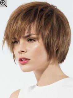Jaw length bob cut with round layers. A bob hairstyle with a round shape and jagged bangs.