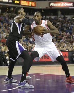 Houston Rockets center Joey Dorsey, right, goes to the basket against Sacramento Kings forward Jason Thompson during the first quarter of an NBA basketball game in Sacramento, Calif., Thursday, Dec. 11, 2014.(AP Photo/Rich Pedroncelli)