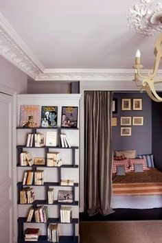 Create an Entryway with a Partial Wall (see the comments for other ideas on dividers for the entryway)