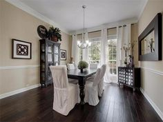 Dining room with dark hardwood floors and natural lighting 15235 Calaveras Dr, Austin, TX 78717