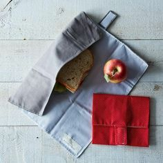 reusable cloth sandwich wraps that also double as a wee table cloth -- no more plastic!