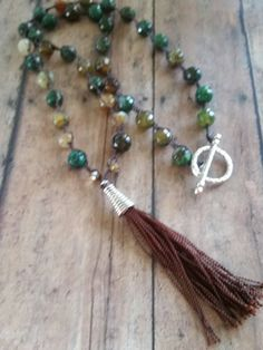 Check out this item in my Etsy shop https://www.etsy.com/listing/227859375/earthybrown-tassle-crochet-beaded