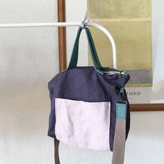 Simply Stunning! This is a better design of my previous Simplicity Bag , its a Perfect Tote Style Messenger bag. This bag made from Purple Colour and Soft Lavender European Linen, lining with 100% cotton in very cute flowers. The bag, the leather handles and strap are measured, cut, sewn