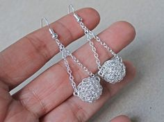 Silver swinging crochet ball earrings. Handmade crochet drop earrings with sterling silver ear wires. Bridal earrings. Crochet wire jewelry....