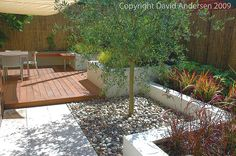 Mediterranean Style Courtyard by David Andersen Garden Design, via Flickr