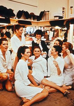 Coco Chanel surrounded by models in the 1960s
