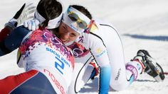Women's Skiathlon Marit Bjorgen (NOR) celebrates with Charlotte Kalla (SWE) at the finish line during the Sochi 2014 Olympic Winter Games at Laura Cross-Country Ski and Biathlon Center.