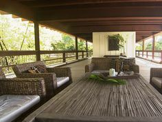 """Is this cool or what? """"Architect Max Strang designs an outdoor living room with a panoramic 360-degree view. Featuring """"ipe"""" wood floors, an amazing ceiling of rusted industrial steel and furnishings from Bali, the space feels like a high-style tree house."""""""
