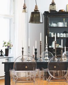 Paint dining table high gloss black or gray, use ghost chairs and two new upholstered host chairs