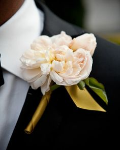grooms bout: Cherries provided the event's florals, including the peach flower boutonnieres wrapped with gold ribbon. -MSW