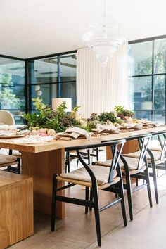 Thanksgiving decorating tip: Stick to lower bouquets, pillar candles, and garlands for the dining table.