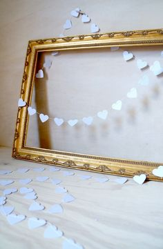 Pure White of Hearts paper garland - 3 metre (9.8 ft) Wedding, Engagement, housewarming, party home decor, photo prop. $14,00, via Etsy.
