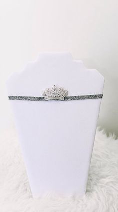 Sofia: Our stunning Sofia mini tiara is a silver tone flat back crown, embellished with rhinestones on a stretchy glitter elastic band.  Suitable for babies up to 12 months. www.petitespoupees.ca