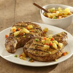 Pineapple salsa offers a refreshing flavor to grilled pork chops marinated in brandy flavors and jalapeño peppers.