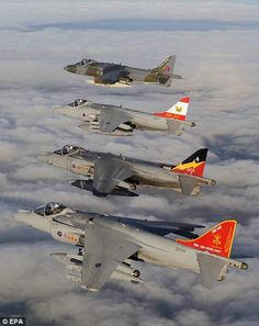 Able bodied: The unusual vertical take-off and landing abilities enabled Harrier jump jets to fly in and out of areas near to the battlefield although the weight of fuel required for vertical take-off limited its weapon load. Four GR9 Harriers, flying in formation over Britain. Nearest to the camera is a GR9 in the tail colours of 800 Naval Squadron, then 4 Squadron, 1 Squadron, the furthest GR9 is painted in the 1969 camouflage pattern