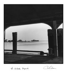 """""""Seaside: Nobska Departs"""", Vintage Black & White seashore photograph by Robert Gambee. The New York Times says, """"Gambee Photos Speak Magic."""". Digital C print. Limited edition, hand -signed and titled by the photographer, Robert Gambee. Over 1500 of his images are in major museums. The original of this image was taken with a twin lens Roleiflex Camera on Nantucket, Massachusetts in 1971. It the view of the harbor from Steamboat Wharf showing the departing Steamship Nobska. This image is..."""
