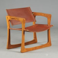 Jens Quistgaard; Teak, Leather and Brass 'Axe' Armchair for IHQ, 1960s.
