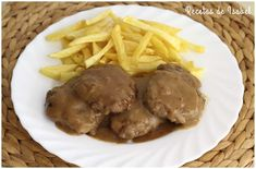 Filetes rusos en salsa, receta casera - Recetas de Isabel
